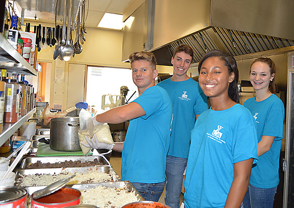 Youth Leadership Academy of Madison County volunteers in the kitchen at The Christian Center in Anderson, Indiana